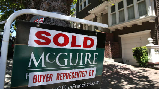Sold sign on a home in San Francisco, May 27, 2014.