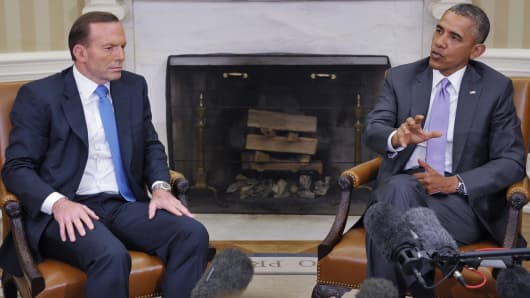 President Barack Obama addresses questions about Iraq during a bilateral meeting with Australian Prime Minister Tony Abbott  in White House on Thursday.