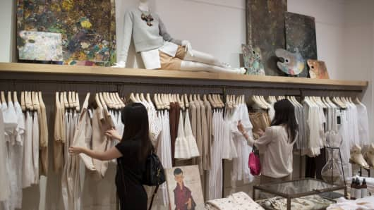 Women browse clothing at the International Finance Centre (IFC) mall in Hong Kong, China.