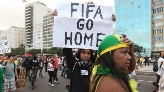 A protestor holds a 'FIFA Go Home' sign during an anti-World Cup demonstration in Rio de Janeiro, Brazil.