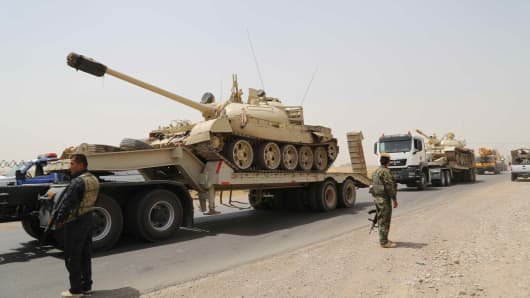 Kurdish Peshmerga forces and Iraqi special forces deploy their troops and armoured vehicles outside of the oil-rich city of Kirkuk, Iraq.