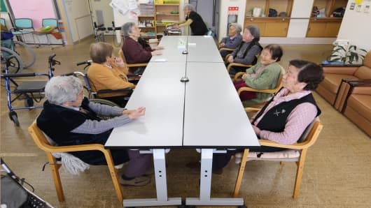 Elderly women wait for lunch to be served at a day care facility on Gogo Island in Matsuyama, Ehime Prefecture, Japan