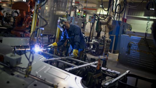 An employee welds truck floors panels at the Volvo AG New River Valley Plant in Dublin, Virginia,