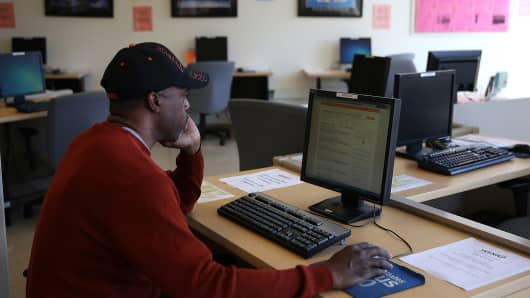 A job seeker uses a computer to search for jobs at the Western Addition Neighborhood Access Point on April 17, 2014 in San Francisco, California.