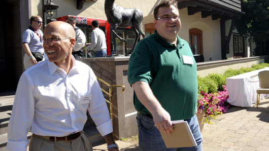 Jeffrey Katzenberg, chief executive officer of DreamWorks Animation SKG Inc., left, walks with Reid Hoffman, co-founder and chairman of LinkedIn Corp., in 2011.