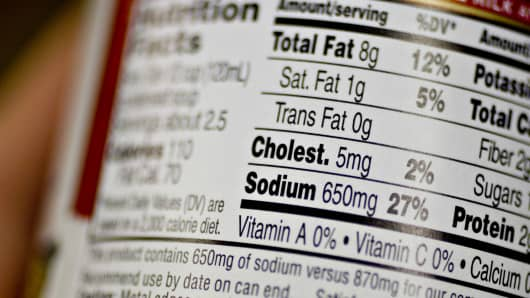 A nutrition facts label displays sodium content in a supermarket in New York.