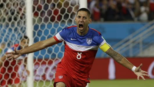 Clint Dempsey celebrates after scoring the opening goal Monday against Ghana.