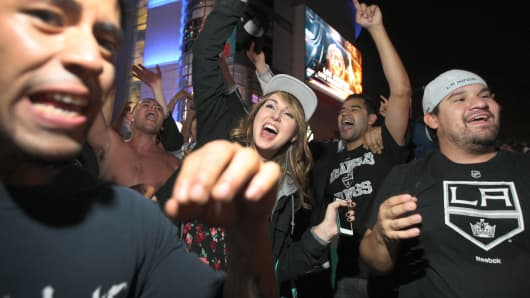 Fans celebrate after the Los Angeles Kings beat the New York Rangers to win the Stanley Cup on June 13, 2014 in Los Angeles, California.