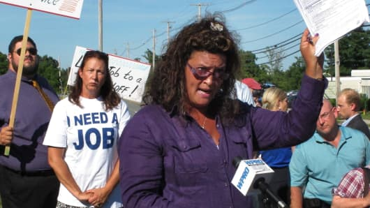 In 2012, demonstrators in Cranston, Rhode Island, protested the layoffs of 67 Department of Labor and Training workers, most of whom worked at the agency's unemployment benefits division.