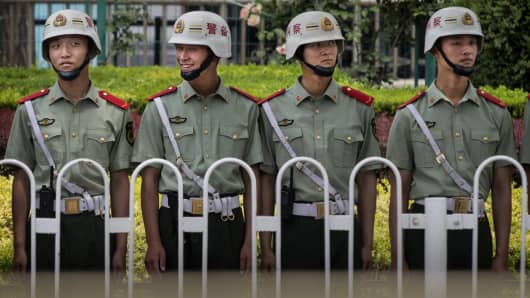 Chinese Paramilitary police stand guard near Tiananmen Square in Beijing, China.