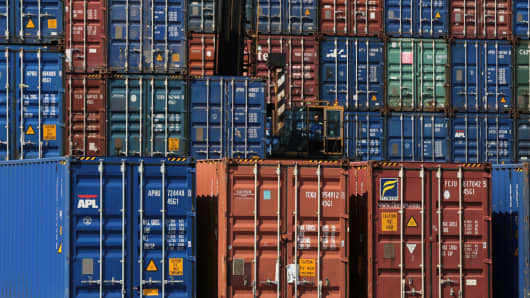 A worker operates a forklift among containers at a shipping terminal in Yokohama City, Kanagawa Prefecture, Japan.