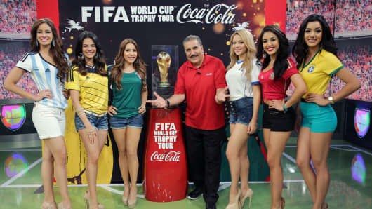 Aleyda Ortiz, Alina Robert, Aly Villegas, Fernando Fiore, Josefina Ochoa, Nabila Tapia and Maria Elena Amaya pose during the FIFA World Cup Trophy Tour during the Nuestra Belleza Latina taping at Univision Headquarters on April 15, 2014, in Miami.