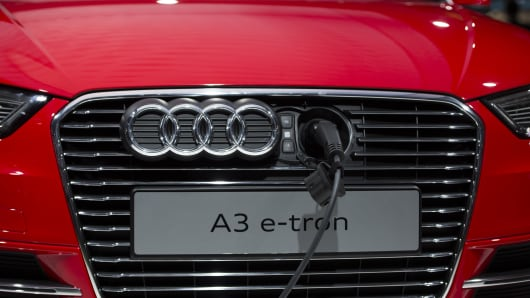 An Audi A3 e-tron electric car is being charged during the media day of the IAA (Internationale Automobil Ausstellung) international motor show in Frankfurt am Main, western Germany.