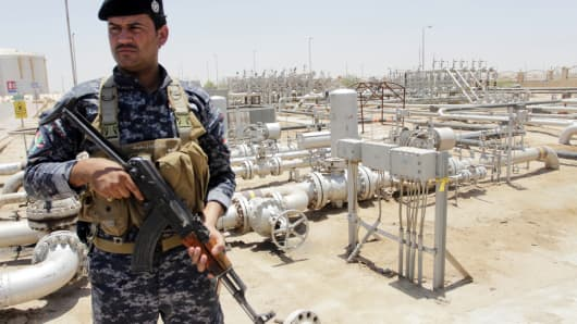 A member from the oil police force stands guard at Zubair oilfield in Basra, southeast of Baghdad June 18, 2014.