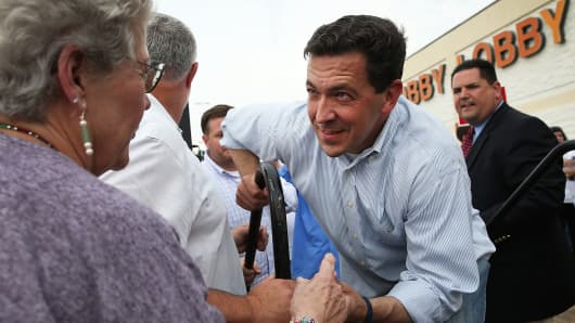 Republican candidate for U.S. Senate, Mississippi State Sen. Chris McDaniel (R) greets a supporter during a Tea Party Express campaign event outside of a Hobby Lobby store on June 22, 2014 in Biloxi, Mississippi.
