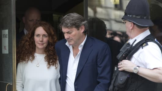 Former News International chief executive Rebekah Brooks and her husband, Charlie, leave the Old Bailey in London. Brooks was acquitted Tuesday of orchestrating a campaign to hack into phones and bribe officials.