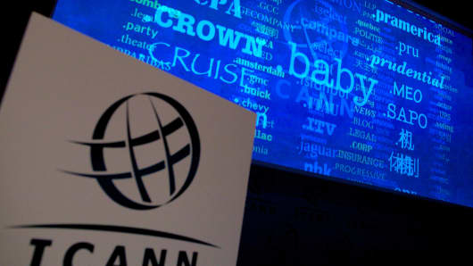 A screen shows a rolling feed of new 'Generic Top-Level Domain Names (gTLDs) which have been applied for during a press conference hosted by ICANN in central London, on June 13, 2012.