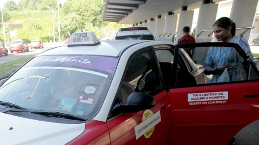 A woman takes a taxi with a special stickers that say 'women taxi' in Putra Jaya, outside Kuala Lumpur.