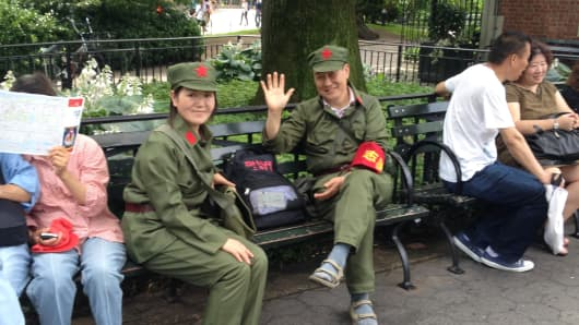 At a lunch in New York City for the homeless, volunteers donned uniforms of Lei Feng, a Chinese communist propaganda symbol of altruism.