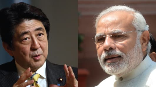 Japan's Prime Minister Shinzo Abe and Indian Prime Minister Narendra Modi