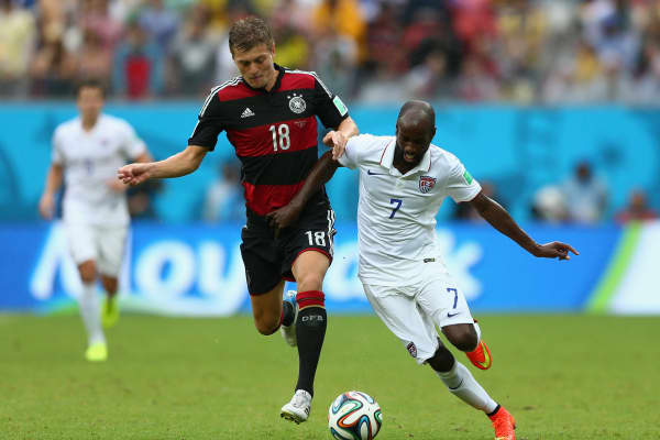Toni Kroos of Germany challenges DaMarcus Beasley of the United States during the 2014 FIFA World Cup