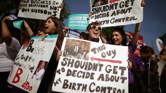 Supporters of employer-paid birth control rally in front of the Supreme Court before the decision in Burwell v. Hobby Lobby Stores was announced June 30, 2014 in Washington.