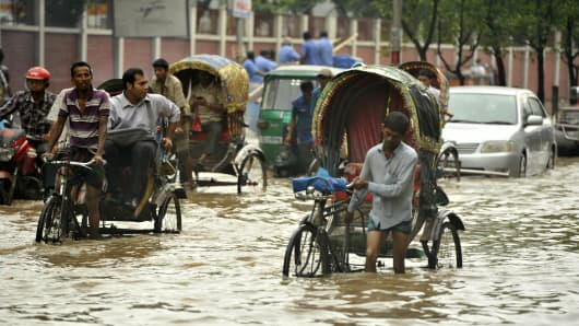 Razarbag Road in Dhaka is submerged by flood water following incessant monsoon rain which has inundated the capital's roads and crossroads throughout the down-town area. The monsoon has forced the evacuation of more than 1 million people.