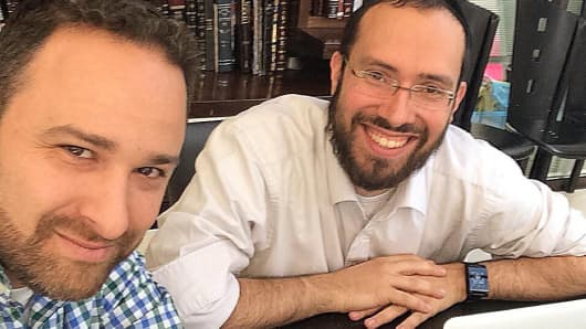 Tech advisor, Hillel Fuld, left, meets with Jeremie Berrebi of Kima Ventures, a haredi angel investor.