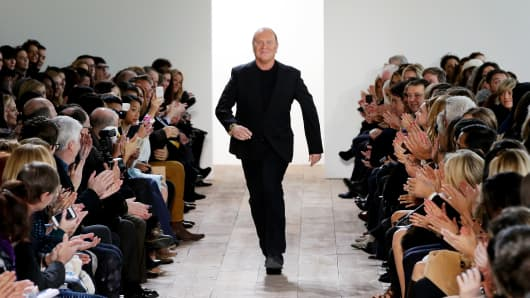 Designer Michael Kors walks the runway at the Michael Kors fashion show during Mercedes-Benz Fashion Week Fall 2014, New York