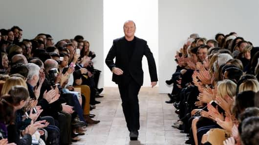 Designer Michael Kors walks the runway at the Michael Kors fashion show during Mercedes-Benz Fashion Week Fall 2014, New York