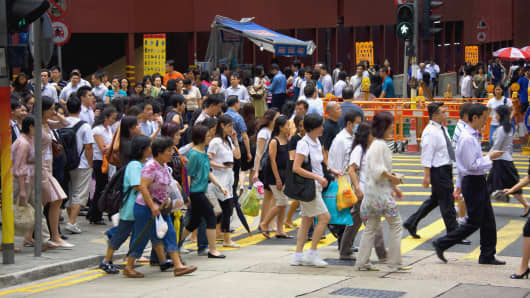 Crowd walking in a street, Hong Kong Island, Hong Kong, China