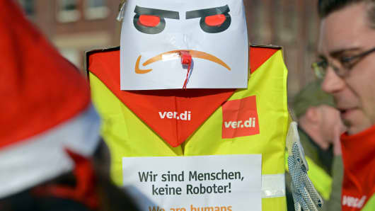 Amazon employees strike in front of the company's logistics center in Bad Hersfeld, Germany