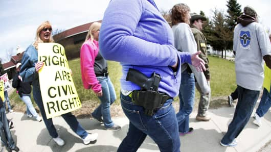 Supporters of Michigan's Open Carry law hold a rally and march April 27, 2014 in Romulus, Michigan.