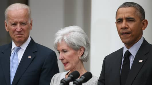 President Barack Obama, then-outgoing Health and Human Services Secretary Kathleen Sebelius, and Vice President Joe Biden at an event in the Rose Garden at the White House, on April 11, 2014.