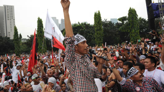 Indonesian frontrunner presidential candidate Joko Widodo addresses supporters during a campaign rally in Jakarta.