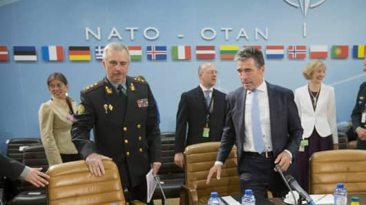 NATO Secretary General Anders Fogh Rasmussen and acting Ukrainian Defense Minister Mikhail Koval