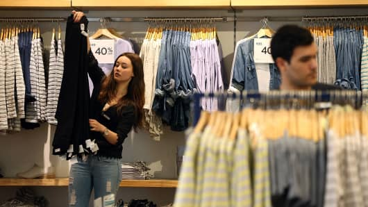 A Gap employee folds clothes at a Gap Store in San Fransisco, California.