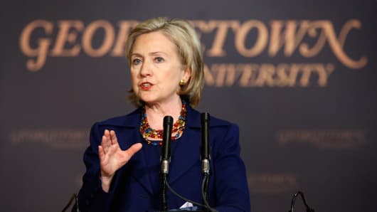 Secretary of State Hillary Rodham Clinton addresses students and faculty members at Georgetown University December 14, 2009 in Washington, DC. Clinton spoke about linking human rights to democracy and economic development, and taking an approach of 'principled pragmatism'.