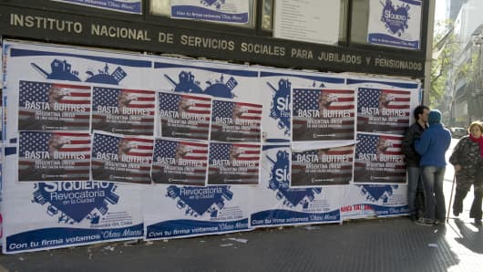 Posters on a wall against the 'vulture funds' in Buenos Aires, Argentina.
