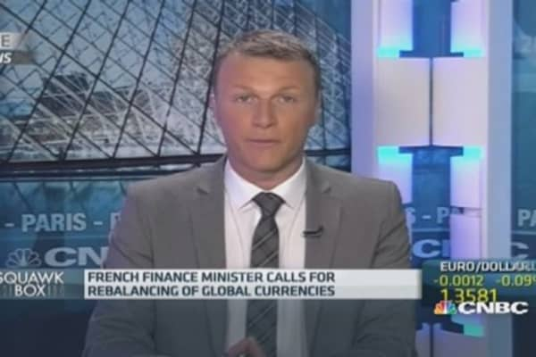 France slams dollar dominance
