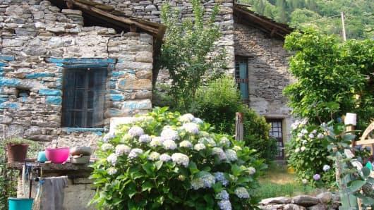 Borgata Calsazio alpine village is for sale on eBay.