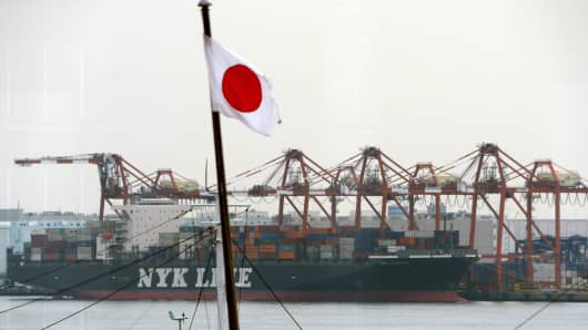 A cargo ship berthes alongside a container wharf in the port of Tokyo.