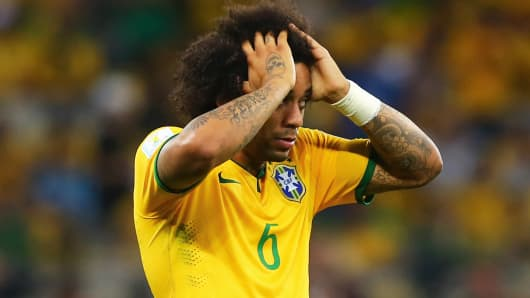 Marcelo of Brazil reacts after allowing a goal during the 2014 FIFA World Cup Brazil Semi Final match between Brazil and Germany at Estadio Mineirao on July 8, 2014 in Belo Horizonte, Brazil.