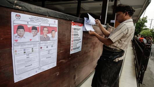 A Balinese man checks his name on a polling station during the Indonesia presidential election on July 9, 2014 in Denpasar, Indonesia.