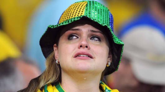 A Brazil fan looks dejected following the 2014 FIFA World Cup Brazil Semi Final match between Brazil and Germany.