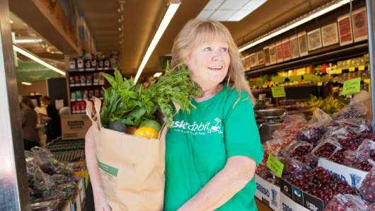 A TaskRabbit worker delivers groceries. The website is part of a growing sharing economy.