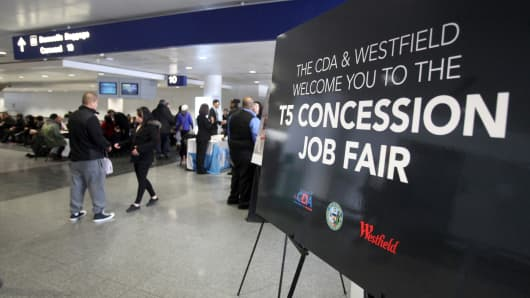 A sign welcomes job seekers to a job fair at O'Hare International Airport in Chicago.