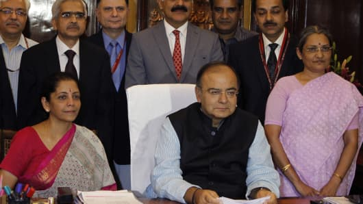 India Finance Minister Arun Jaitley with Minister of State for Finance, Nirmala Sitharaman and officials while giving final touches to the Annual Budget 2014-15.