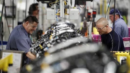 Employees assemble 2.0 liter ecoboost engines on the production line at the Ford Motor Co. Cleveland Engine Plant in Brook Park, Ohio.