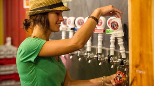 A server pours a Highland Brewing ale at the company's brewpub in Asheville, N.C.
